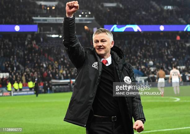 TOPSHOT Manchester United's Norwegian headcoach Ole Gunnar Solskjaer gestures at the end of the UEFA Champions League round of 16 secondleg football...
