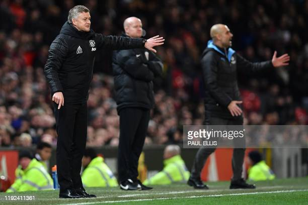 Manchester United's Norwegian manager Ole Gunnar Solskjaer and Manchester City's Spanish manager Pep Guardiola shout instruction to their players...