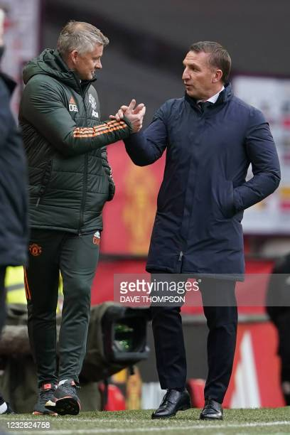 Manchester United's Norwegian manager Ole Gunnar Solskjaer and Leicester City's Northern Irish manager Brendan Rodgers shake hands ahead of the...
