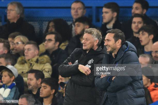 Manchester United's Norwegian manager Ole Gunnar Solskjaer and Chelsea's English head coach Frank Lampard gesture during the English League Cup...