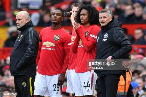 Manchester United's Norwegian manager Ole Gunnar Solskjaer and Manchester United's English firstteam coach Mike Phelan stand by as Manchester...