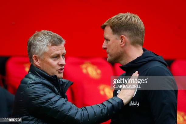 Manchester United's Norwegian manager Ole Gunnar Solskjaer and Bournemouth's English manager Eddie Howe congratulate each other at the end of the...