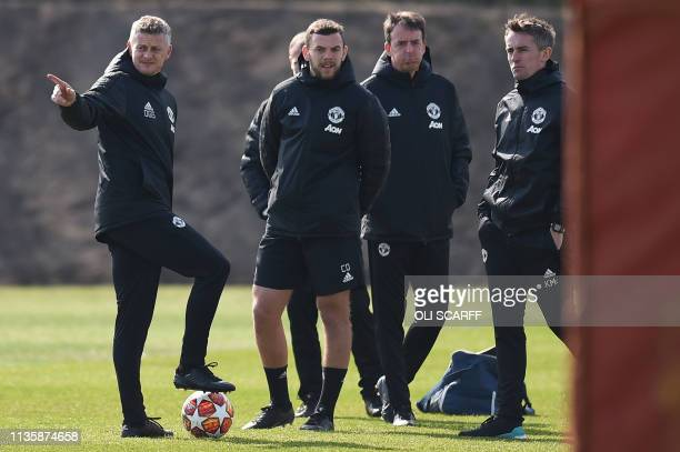 Manchester United's Norwegian manager Ole Gunnar Solskjaer and players attend a training session at the Carrington training ground in greater...