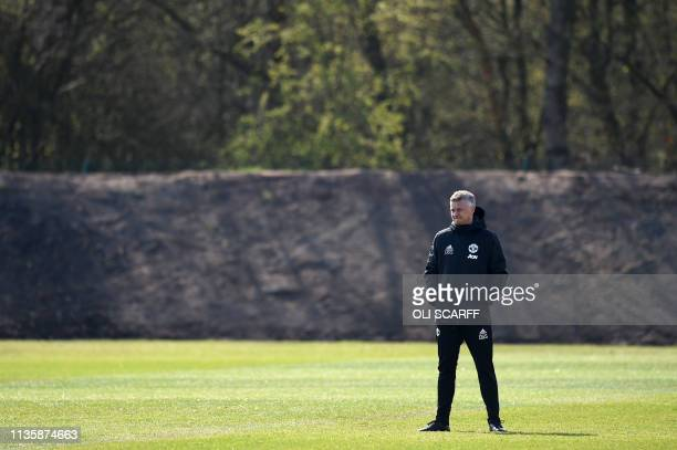 Manchester United's Norwegian manager Ole Gunnar Solskjaer attend a training session at the Carrington training ground in greater Manchester north...