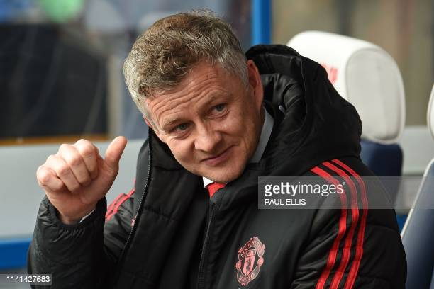 Manchester United's Norwegian manager Ole Gunnar Solskjaer awaits kick off in the English Premier League football match between Huddersfield Town and...