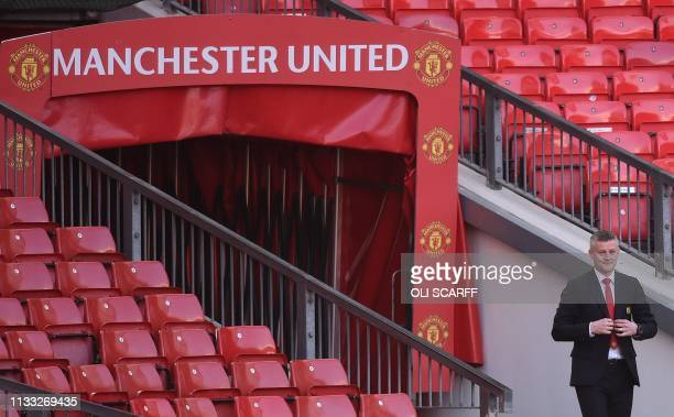 Manchester United's Norwegian manager Ole Gunnar Solskjaer emerges from the tunnel to take part in a photo call at Old Trafford in Manchester...