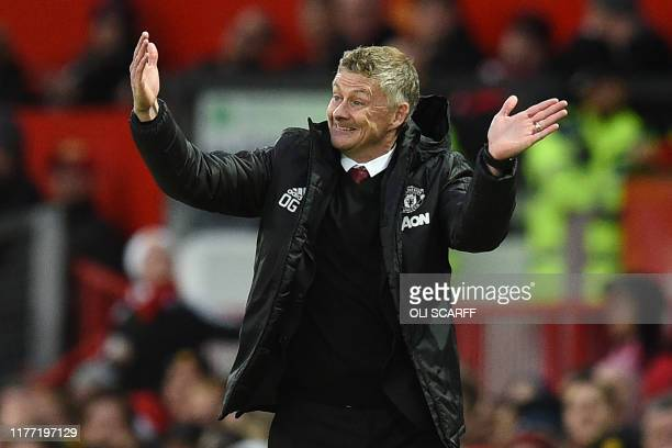 Manchester United's Norwegian manager Ole Gunnar Solskjaer gestures on the touchline during the English Premier League football match between...