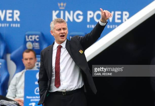 Manchester United's Norwegian manager Ole Gunnar Solskjaer gestures from the touchline during the English Premier League football match between...