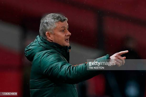 Manchester United's Norwegian manager Ole Gunnar Solskjaer gestures during the English Premier League football match between Manchester United and...