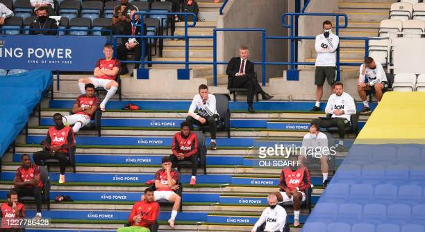 Manchester United's Norwegian manager Ole Gunnar Solskjaer is seen on the socially distanced bench during the English Premier League football match...