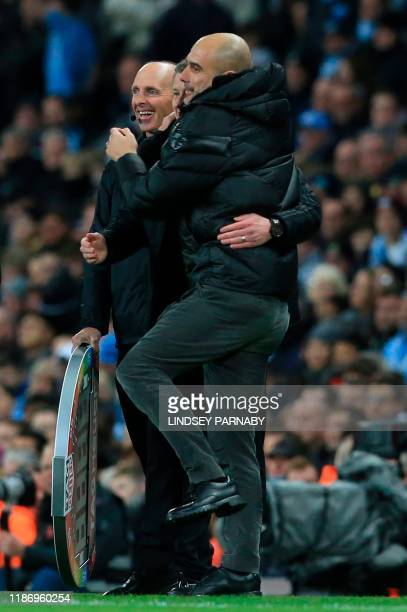 Manchester United's Norwegian manager Ole Gunnar Solskjaer jokes with Manchester City's Spanish manager Pep Guardiola during the English Premier...