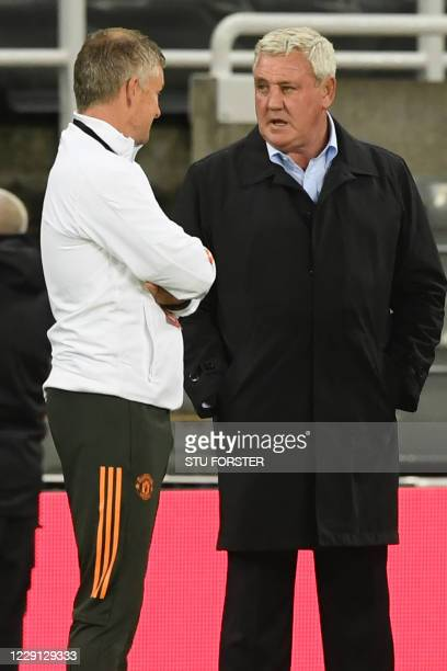 Manchester United's Norwegian manager Ole Gunnar Solskjaer L0 and Newcastle United's English head coach Steve Bruce chat on the touchline ahead of...