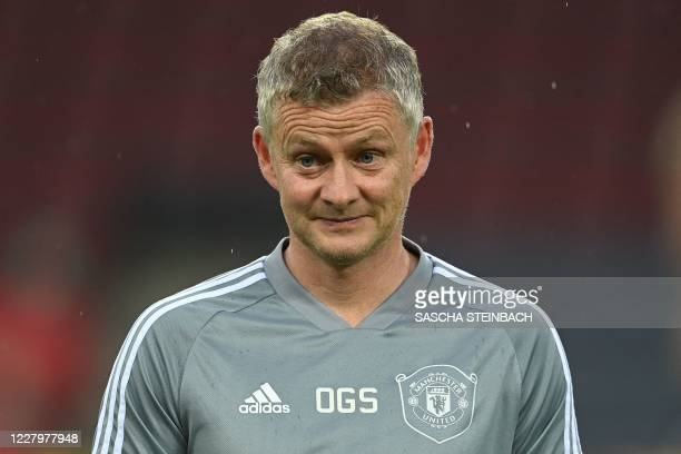 Manchester United's Norwegian manager Ole Gunnar Solskjaer oversees a training session on the eve of the UEFA Europa League quarter-final football...