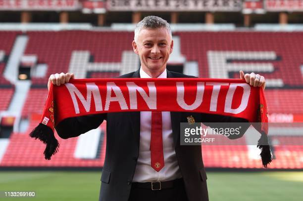 Manchester United's Norwegian manager Ole Gunnar Solskjaer poses during a photo call at Old Trafford in Manchester northwest England on March 28 2019...