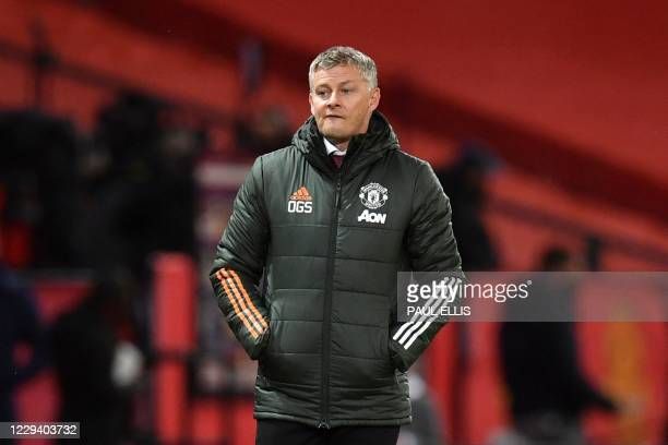 Manchester United's Norwegian manager Ole Gunnar Solskjaer reacts on the touchline during the English Premier League football match between...
