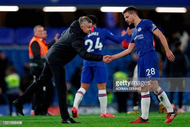Manchester United's Norwegian manager Ole Gunnar Solskjaer shakes hands with Chelsea's Spanish defender Cesar Azpilicueta after the English Premier...