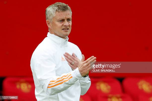Manchester United's Norwegian manager Ole Gunnar Solskjaer shouts instructions to his players from the touchline during the English Premier League...
