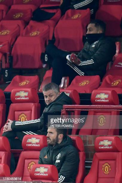 Manchester United's Norwegian manager Ole Gunnar Solskjaer sits in the stands during the English League Cup semi final first leg football match...