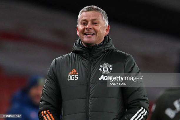 Manchester United's Norwegian manager Ole Gunnar Solskjaer smiles on the touchline during the English Premier League football match between Arsenal...