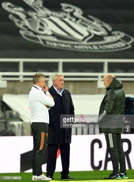 Manchester United's Norwegian manager Ole Gunnar Solskjaer speaks to Newcastle United's English head coach Steve Bruce and Manchester United's...