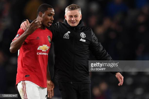 Manchester United's Norwegian manager Ole Gunnar Solskjaer talks to Manchester United's Nigerian striker Odion Ighalo after winning the English FA...