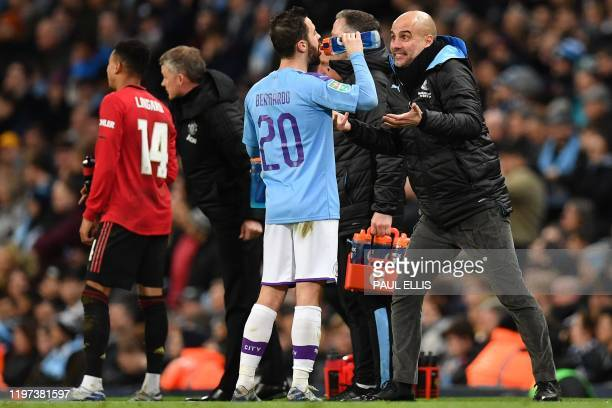Manchester United's Norwegian manager Ole Gunnar Solskjaer talks with Manchester United's English midfielder Jesse Lingard as Manchester City's...
