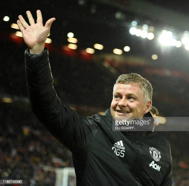 Manchester United's Norwegian manager Ole Gunnar Solskjaer waves to the crowd during the UEFA Europa League Group L football match between Manchester...
