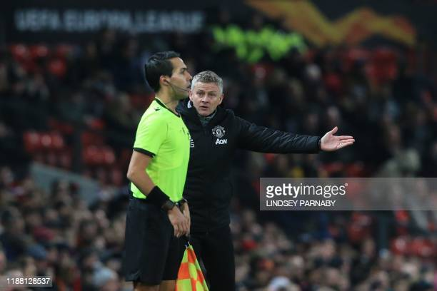 Manchester United's Norwegian manager Ole Gunnar Solskjaer remonstrates with the assistant referee during the UEFA Europa League group L football...