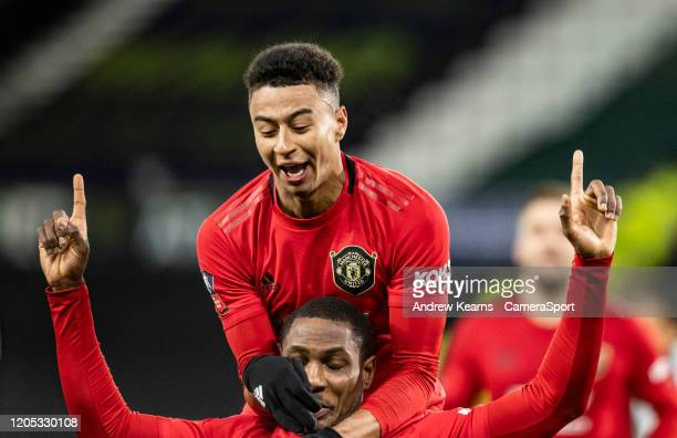 Manchester United's Odion Ighalo celebrates scoring his side's second goal with team mate Jesse Lingard during the FA Cup Fifth Round match between...