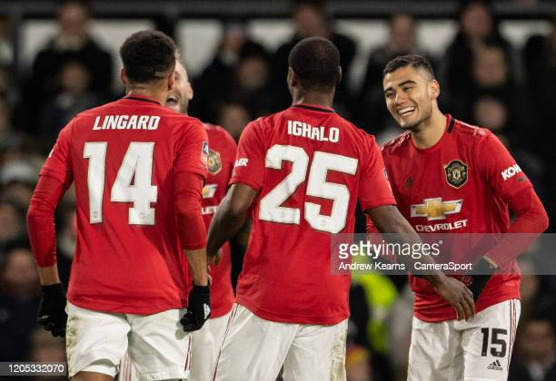 Manchester United's Odion Ighalo is congratulated by team mate Andreas Pereira on scoring his side's third goal during the FA Cup Fifth Round match...