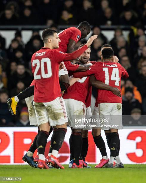 Manchester United's Odion Ighalo is mobbed by team mates on scoring his side's third goal during the FA Cup Fifth Round match between Derby County...