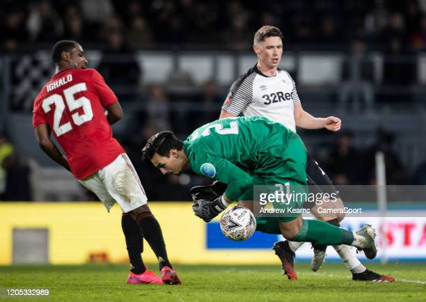 Manchester United's Odion Ighalo looks on as Derby County's goalkeeper Kelle Roos gathers during the FA Cup Fifth Round match between Derby County...
