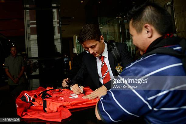 Manchester United's off season acquisition Andrea Herrera signs a jersey for fans as he and fellow squad members arrive at their hotel Manchester...