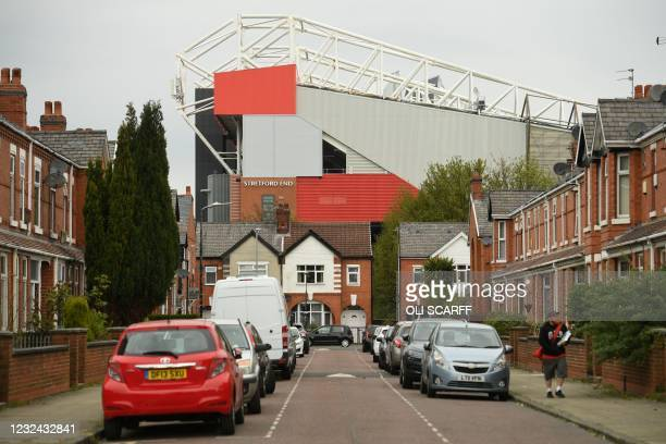 Manchester United's Old Trafford stadium rises above the nearby residential streets in Manchester, northwest England on April 21, 2021. - The...