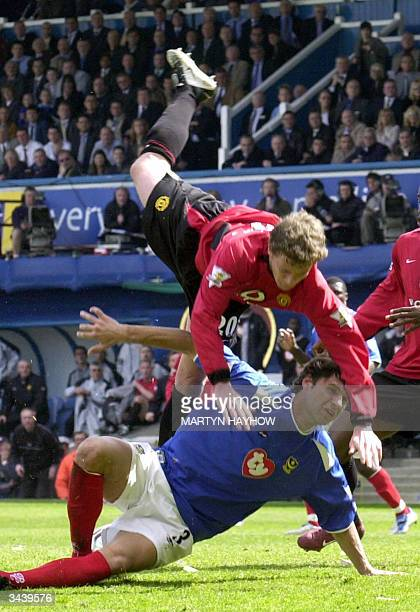 Manchester United's Ole Gunner Solskjaer colliedes with Portsmouth's Dejan Stefanovic during their Premiership football match 17 April, 2004 in...