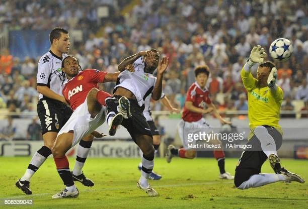 Manchester United's Oliveira Anderson battles Valencia's David Navarro Luis Miguel and Valencia's goalkeeper Sanchez Cesar for the ball