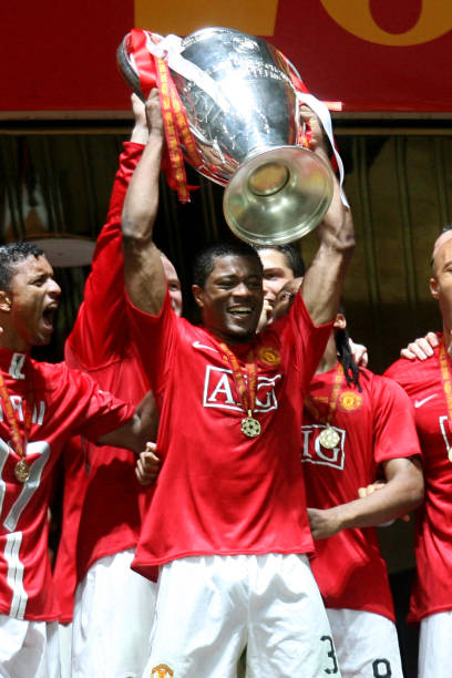 Manchester Uniteds Patrice Evra Lifts The Champions League Trophy