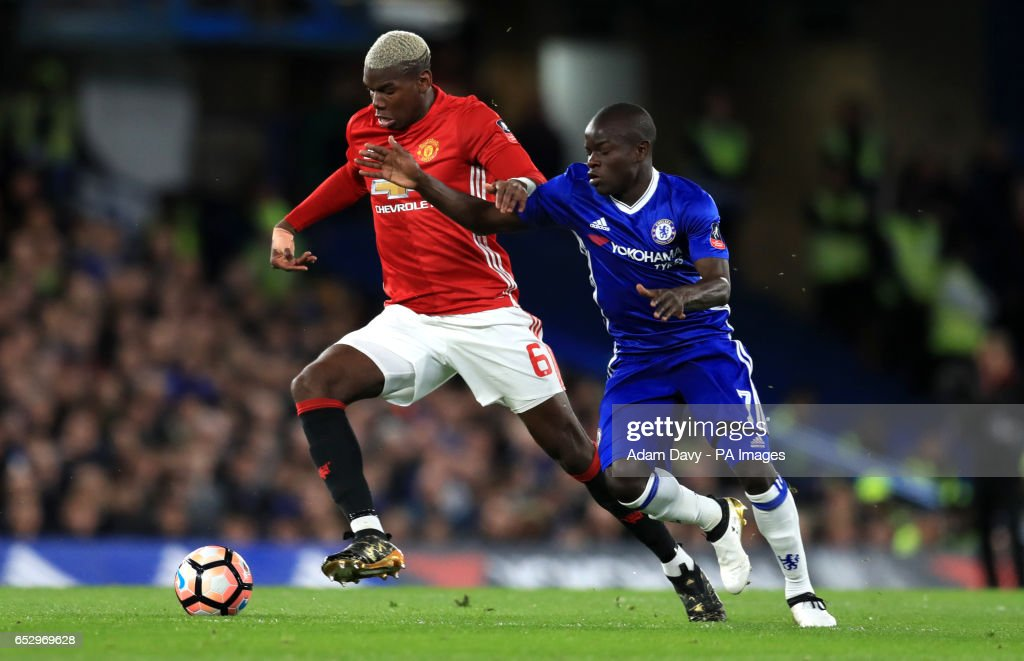 Manchester United's Paul Pogba and Chelsea's N'Golo Kante battle for the ball during the Emirates FA Cup, Quarter Final match at Stamford Bridge, London.