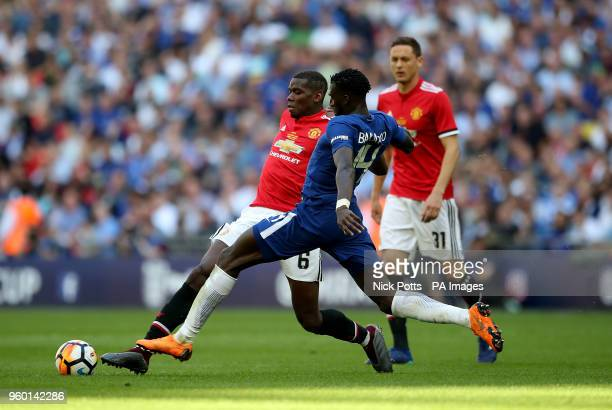 Manchester United's Paul Pogba and Chelsea's Tiemoue Bakayoko battle for the ballduring the Emirates FA Cup Final at Wembley Stadium London
