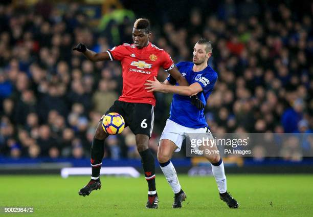 Manchester United's Paul Pogba and Everton's Morgan Schneiderlin battle for the ball during the Premier League match at Goodison Park Liverpool