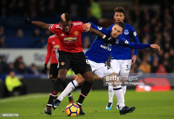 Manchester United's Paul Pogba and Everton's Tyias Browning battle for the ball during the Premier League match at Goodison Park Liverpool