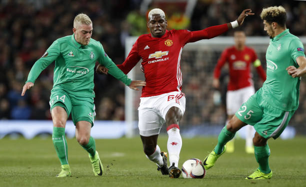 e2021639b2f Manchester United s Paul Pogba and Saint Etienne s Jordan Veretout (left)  battle for the ball