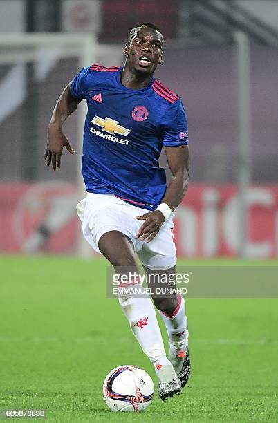 Manchester United's Paul Pogba drives the ball during the UEFA Europa League football match between Feyenoord Rotterdam and Manchester United at the...