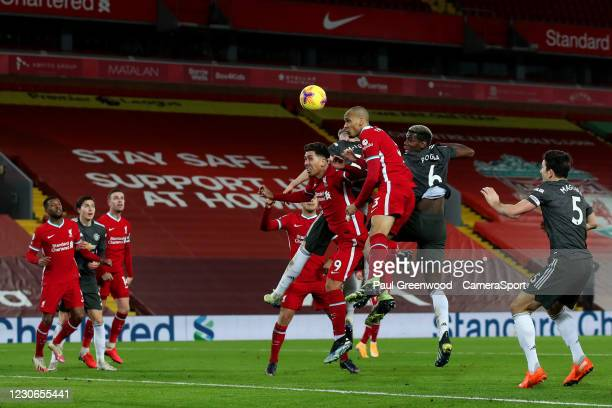 Manchester United's Paul Pogba heads at goal during the Premier League match between Liverpool and Manchester United at Anfield on January 17, 2021...
