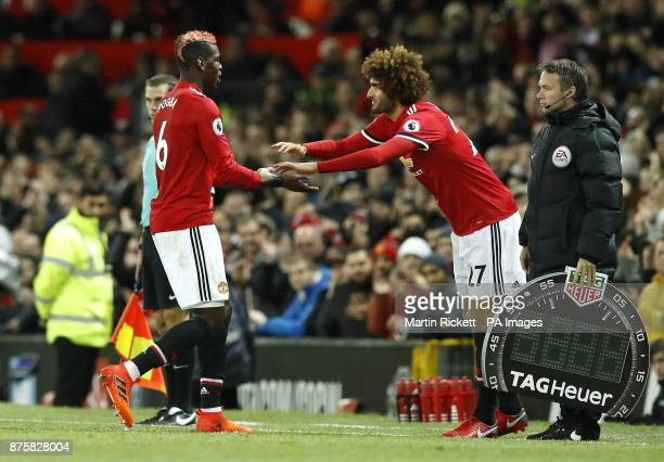Manchester United's Paul Pogba is substituted off the pitch for Marouane Fellaini during the Premier League match at Old Trafford Manchester
