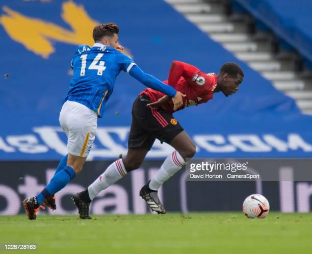 Manchester United's Paul Pogba under pressure from Brighton Hove Albion's Adam Lallana during the Premier League match between Brighton Hove Albion...