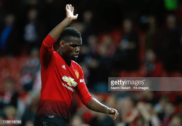 Manchester United's Paul Pogba waves to the fans as he leaves the pitch after the Premier League match at Old Trafford Manchester