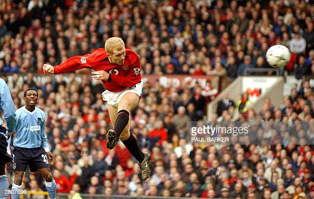 Manchester United's Paul Scholes heads in a tremendous opening goal to make it 1-nil against Manchester City during today's Premiership clash at Old...
