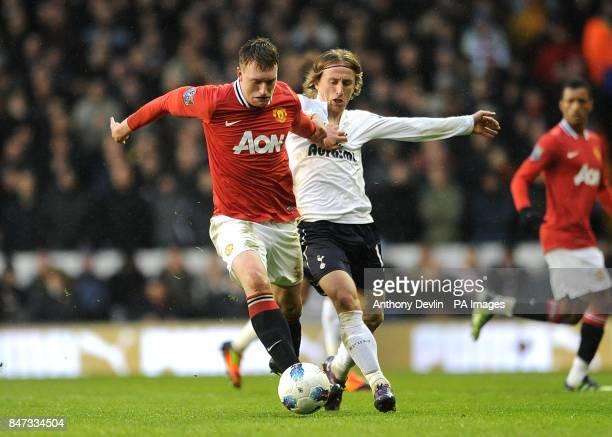 Manchester United's Phil Jones and Tottenham Hotspur's Luka Modric battle for the ball
