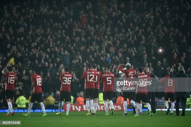 Manchester United's players and manager applauds their fans after the English FA Cup fifth round football match between Blackburn Rovers and...